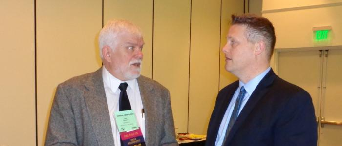President Quattrin and MAGE Lobbyist Todd Tennis of Capitol Services Discussing Legislation